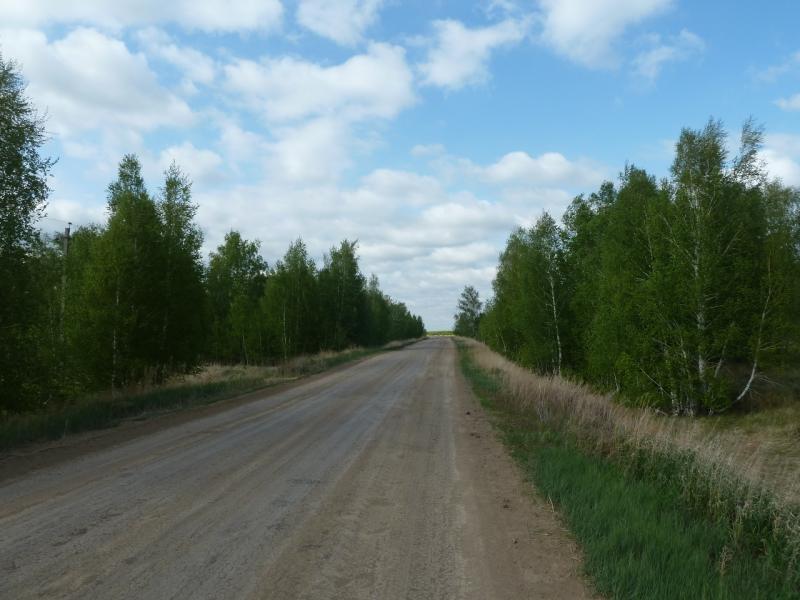 20120521. Пограничными местами: грунтовый грейдер Ескара-Новокузьминка.