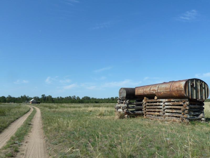 20120513. Сосновыми борами ВКО: бочки с водой у КПП на границе леса.